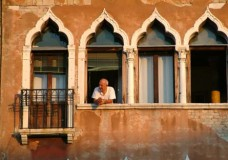 Venice man in four windows